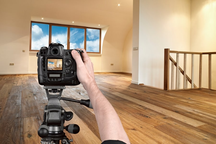 picture of a professional real estate photographer taking a picture of a house
