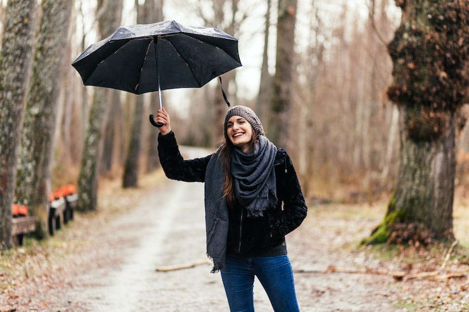 picture of a woman enjoying the rain