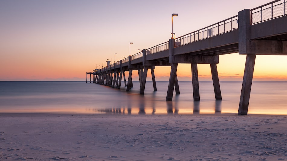 picture of Panorama of Okaloosa fishing pier in Fort Walton Beach, Florida at sunset.
