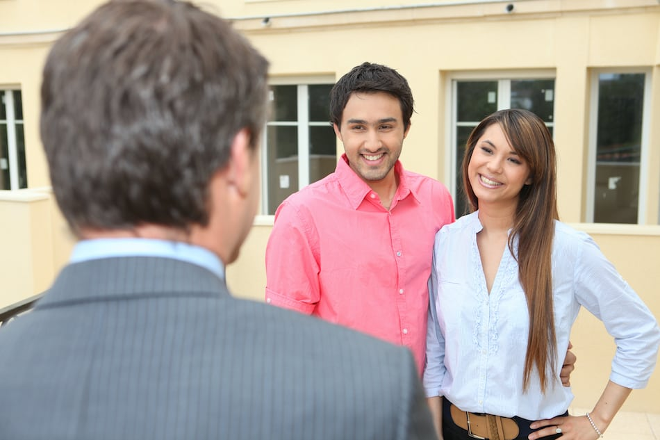 picture of a couple negotiating buying a house