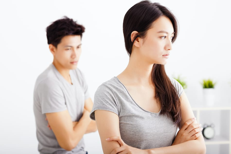 picture of young Couple not talking after  fight  in living room