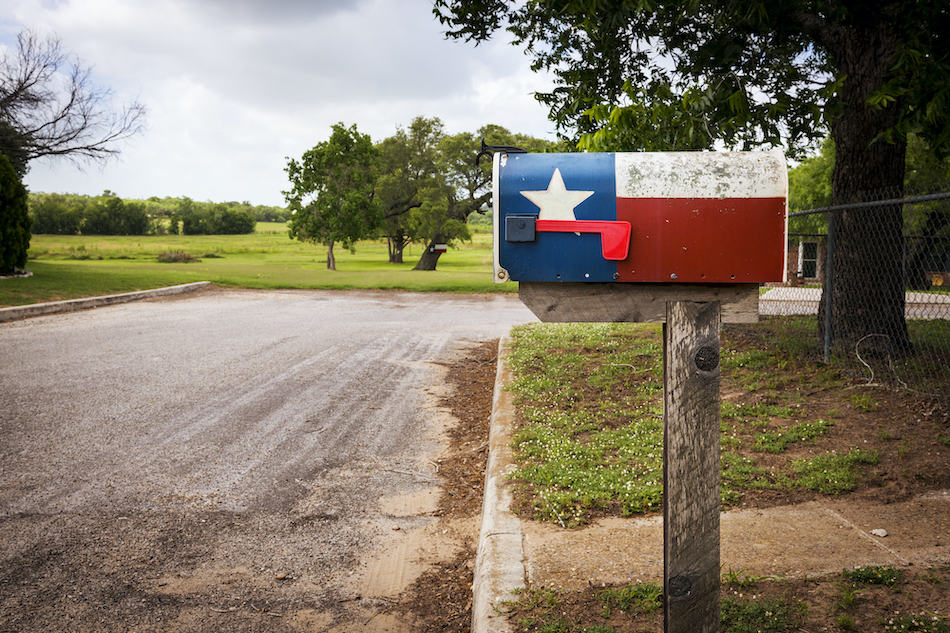 picture of Mailbox painted with the Texas Flag in a street in Texas, USA