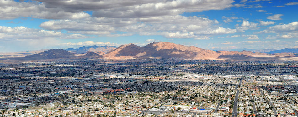 picture of Las Vegas Aerial Panorama with city skyline, mountain and streets.
