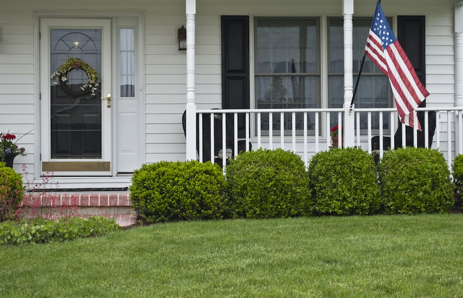 picture of a front porch with an american flag