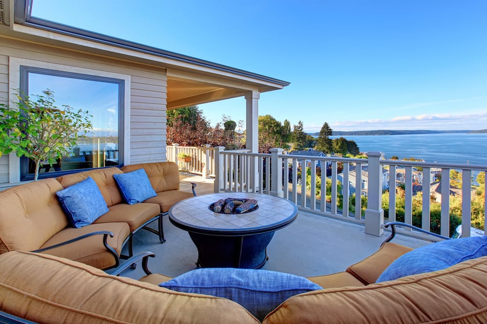 picture of Cozy patio area with comfort settees and fire pit. Deck with Puget Sound view. Tacoma, WA