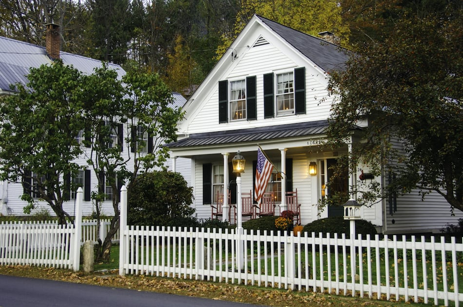 picture of White clapboard house with a white picket fence