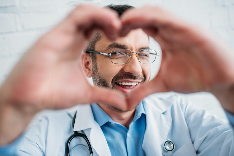 picture of a Rhode Island medical professional making a heart with hands