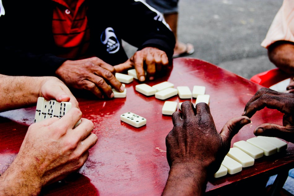 picture of men playing dominoes on sunday in Alabama