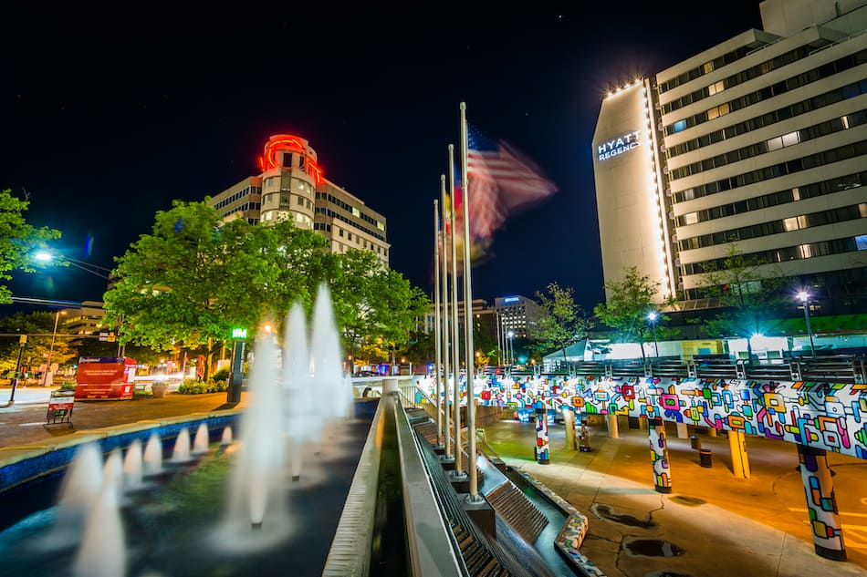 picture of Fountains and modern buildings at night, in downtown Bethesda, Maryland.