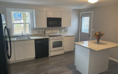 Kitchen with breakfast nook including additional cabinet space