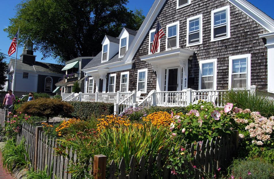 PROVINCETOWN, MASSACHUSETTS:   A handsome Cape Cod shingled home with white trimmed windows and two upstairs dormers