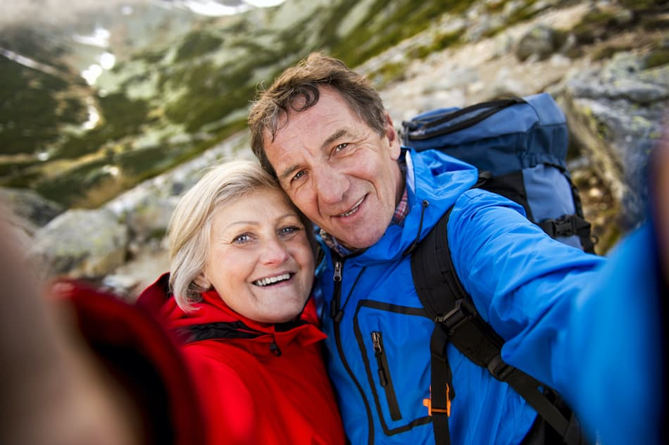 picture of a retired couple hiking on a mountain