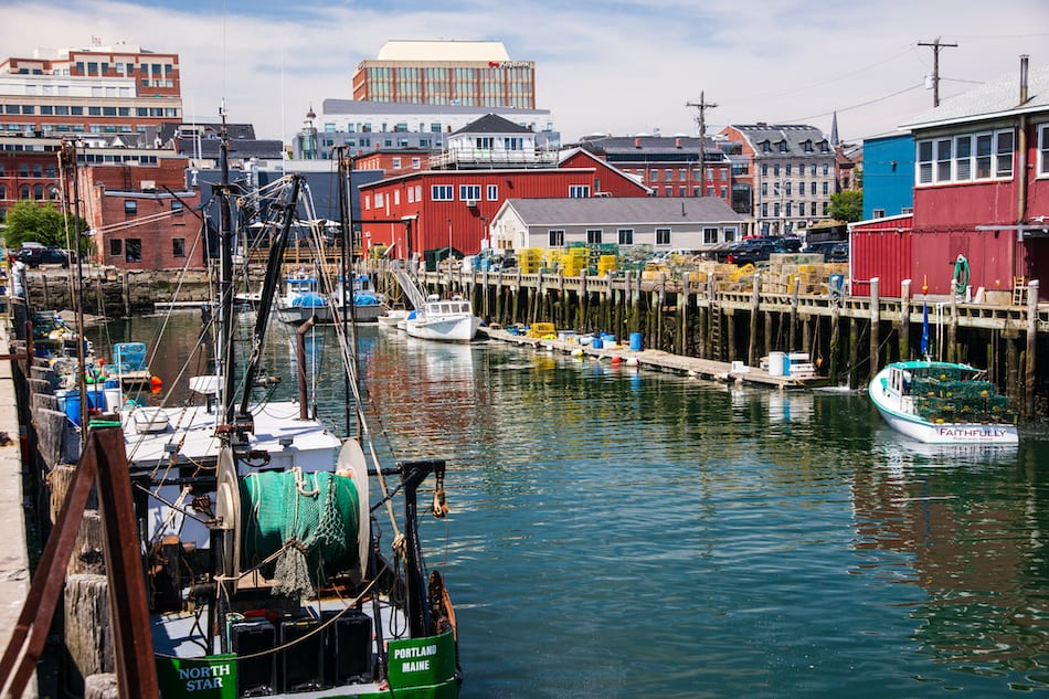 PORTLAND, ME, USA, AUGUST 10, 2015: Scenic view of working fishing ships and boats, dockside in Portland Maine's harbor.