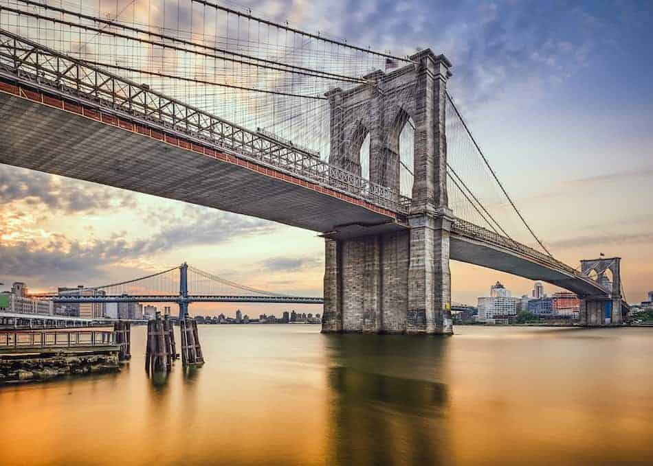 Brooklyn Bridge in New York City, USA at dawn.