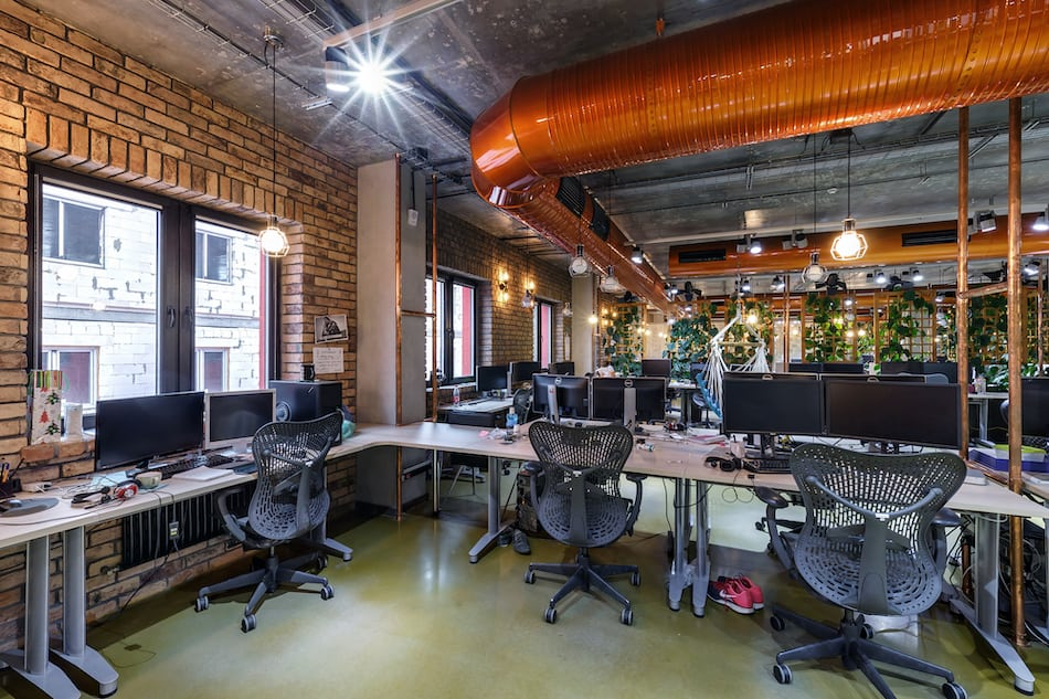 interior of work room in modern coworking in loft style