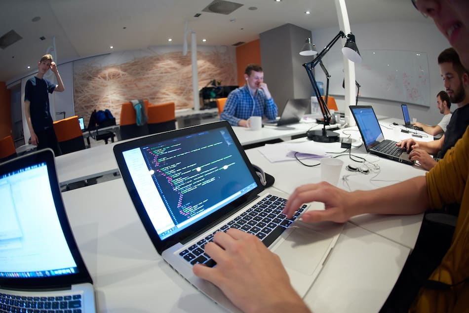 picture of a software developer coding at work in Utah office