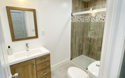 All newly renovated bathroom with ceiling heat and fan, glass doors and very modern.