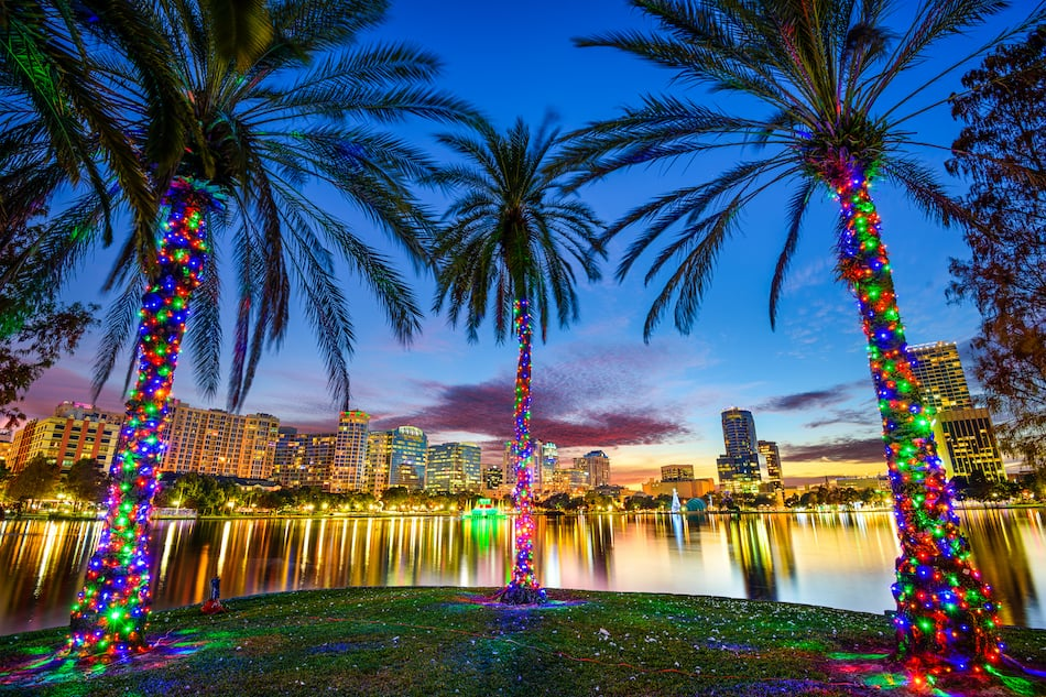Orlando, Florida, USA downtown cityscape from Eola Lake.