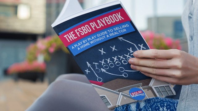 picture of a woman reading our fsbo playbook