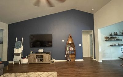 Accent wall. Formal dining on right with natural light.